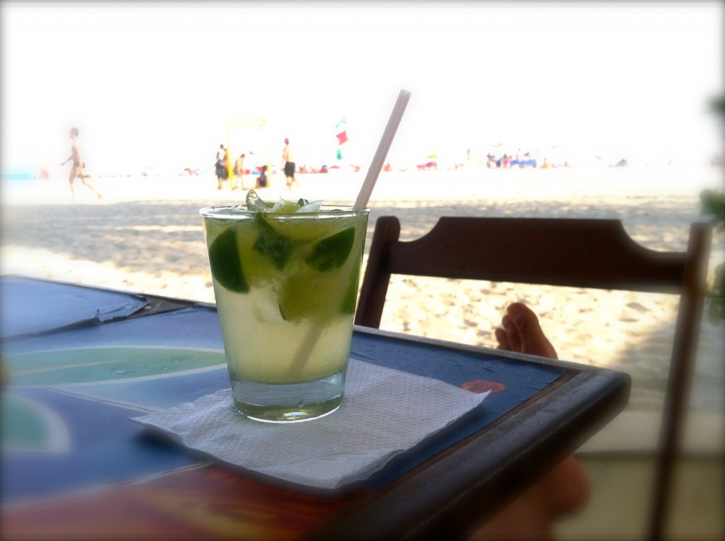 Enjoying a caipirinha at Ipanema beach